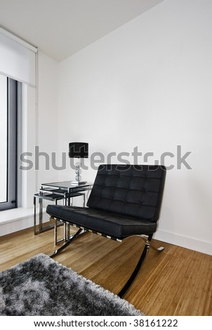 contemporary designer armchair on chrome frome and leather cushions - stock photo