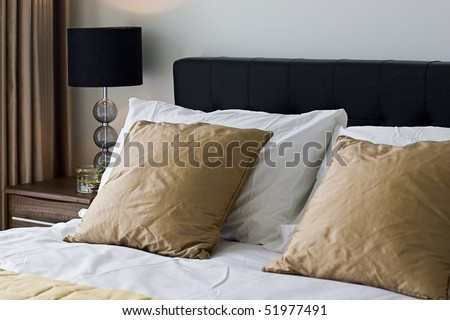 contemporary double bed detail with luxury accessory - stock photo