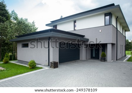 Contemporary driveway parking of the big modern house - stock photo