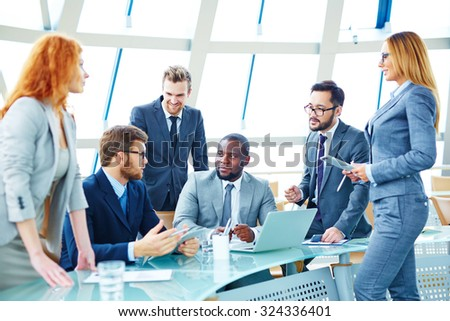 Contemporary employees discussing working plans at meeting - stock photo