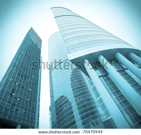 contemporary glass skyscrapers at night - stock photo