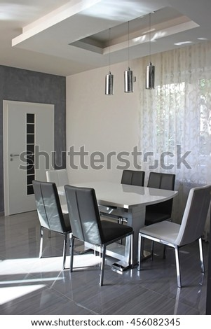 Contemporary gray dining room with table and six chairs