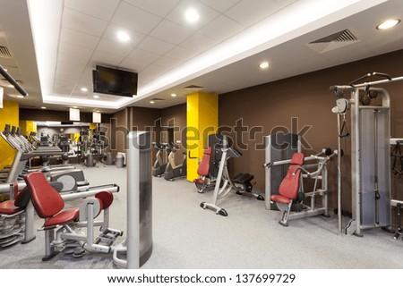 Contemporary gym interior with a special equipment - stock photo