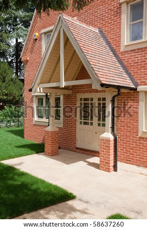 Contemporary home with large pitched roof canopy above the door & Contemporary Home Large Pitched Roof Canopy Stock Photo 58637260 ...