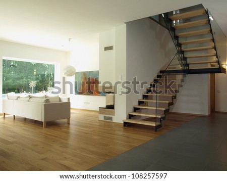 Contemporary house: staircase and a living room