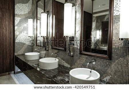 Contemporary Interior Of Public Toilet
