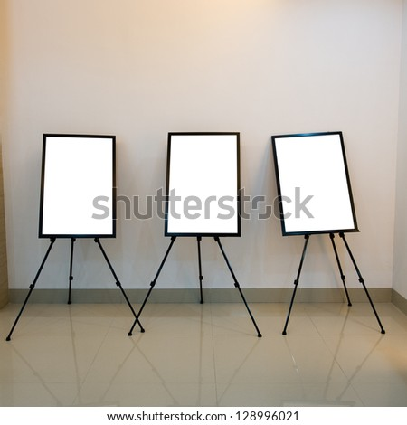 Contemporary interior with blank frames for your exhibition.