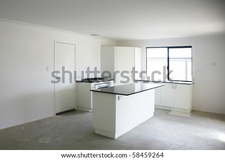 Contemporary kitchen being renovated with tile on floor. - stock photo