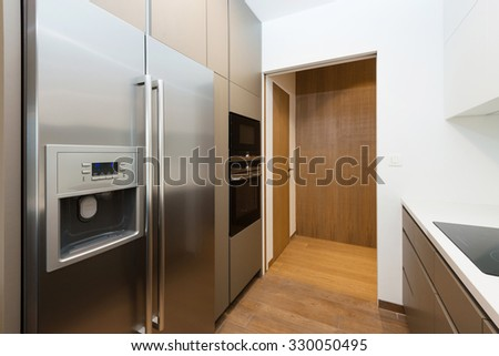Contemporary kitchen interior with with built-in appliances - stock photo