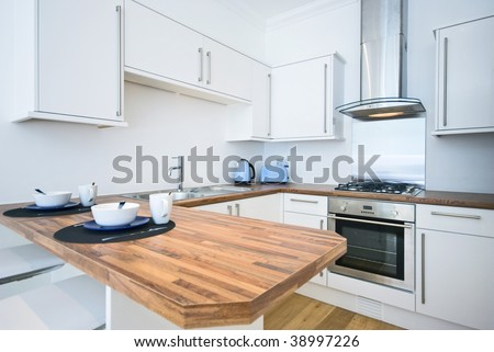contemporary kitchen with a breakfast bar - stock photo