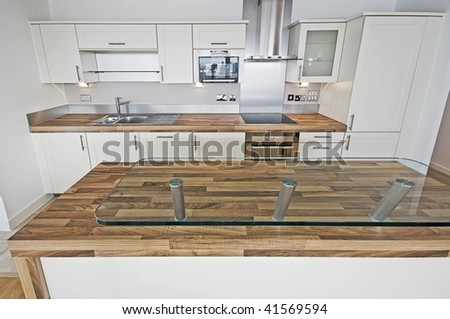 contemporary kitchen with breakfast bar and serving area - stock photo