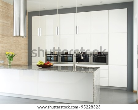 Contemporary kitchen with food and flowers. - stock photo