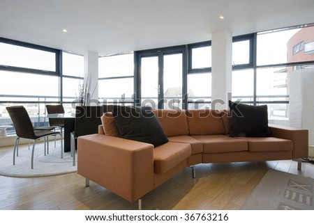 contemporary living room in a penthouse apartment - stock photo
