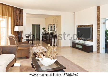 Contemporary living room in brown tones - stock photo