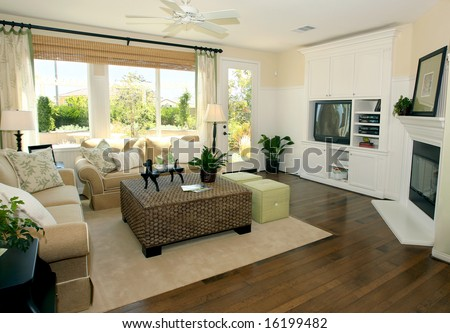 Contemporary living room in earth tones - stock photo