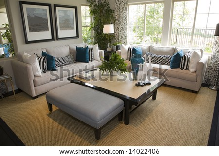 Contemporary living room with a fireplace and stylish decor. - stock photo