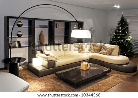 Contemporary living room with big sitting area - stock photo