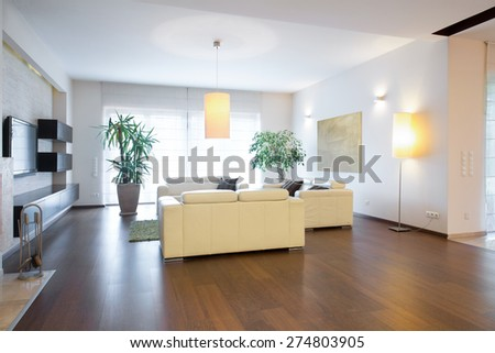 Contemporary living room with oak floor - stock photo