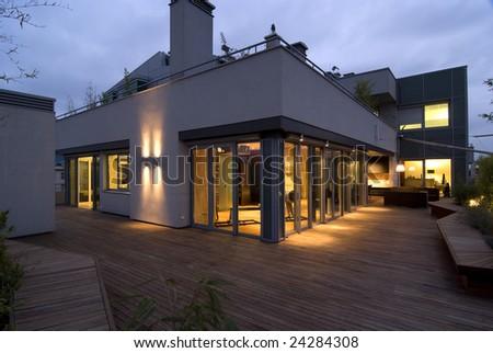contemporary loft - terrace by night - stock photo