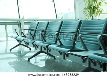contemporary lounge with seats in the airport - stock photo