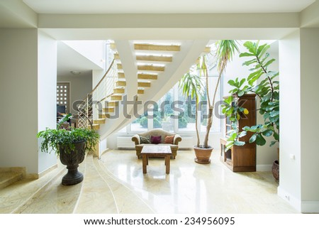 Contemporary luxury mansion interior with spiral stairs - stock photo