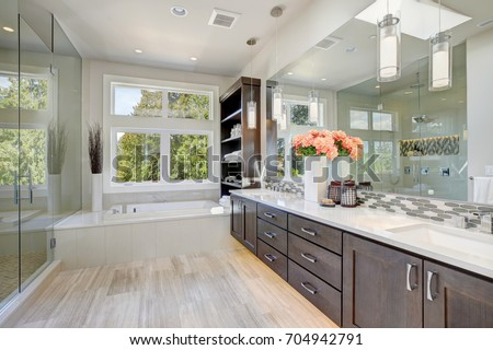 Contemporary Master Bathroom Features A Dark Dual Vanity Cabinet , Glass  Walk In Shower,