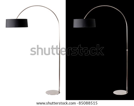 Contemporary metallic and black floor lamp on white and black backgrounds. Clipping path included for both, so you can easily cut it out and place over the top of a design. - stock photo