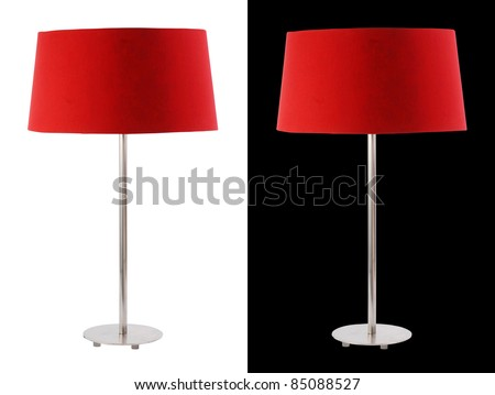 Contemporary metallic and red fabric table lamp isolated on white and black backgrounds. Included clipping path, so you can easily cut it out and place over the top of a design.