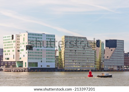 Contemporary office buildings alongside the IJ river waterfront in Amsterdam  - stock photo