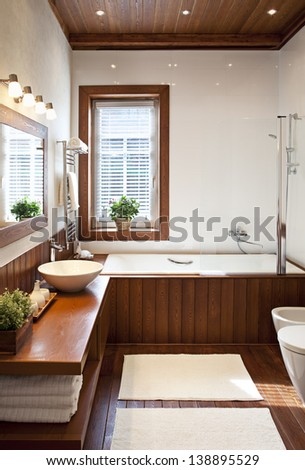 Contemporary residential home bathroom interior in sunlight  - stock photo