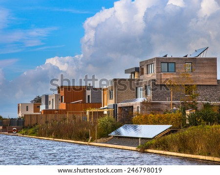 Contemporary residential Middle Class Houses on the Water Front in a Suburban Area - stock photo