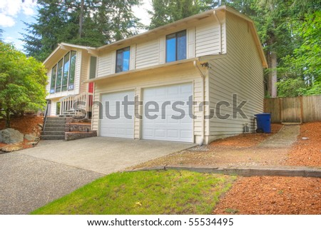Contemporary single family house in green setting - stock photo