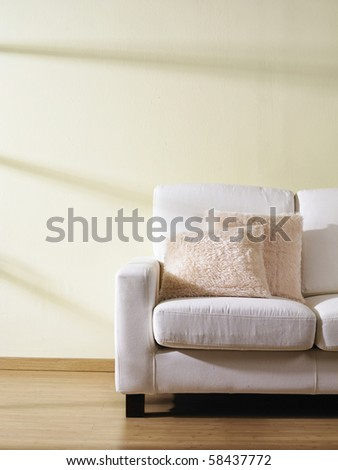 Contemporary sofa with two cushions. - stock photo