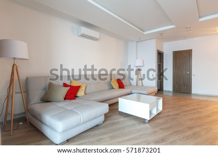 Contemporary Spacious Living Room With Hardwood Floor, White Ceiling,  Golden Curtains, Grey Innovative