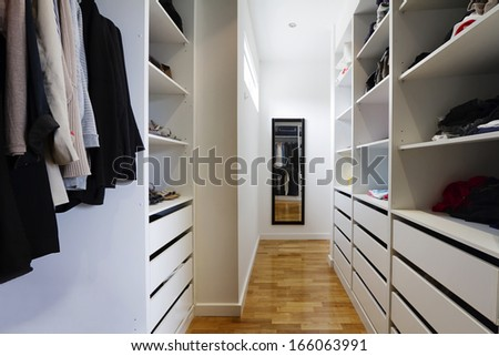 Contemporary spacious walk in wardrobe in a modern home - stock photo