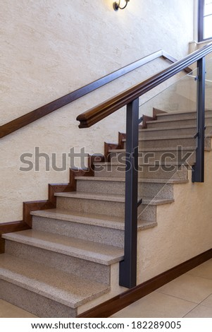 Contemporary staircase, stone and wood, vertical photo - stock photo