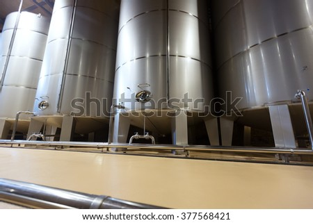 contemporary stell barrels in winery