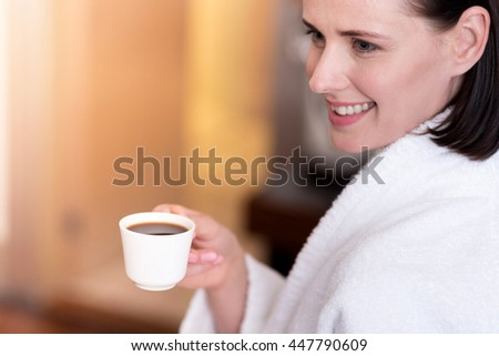 Content beautiful woman drinking coffee,