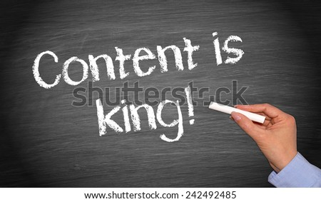 Content is king ! - Female hand with chalk writing on blackboard - stock photo