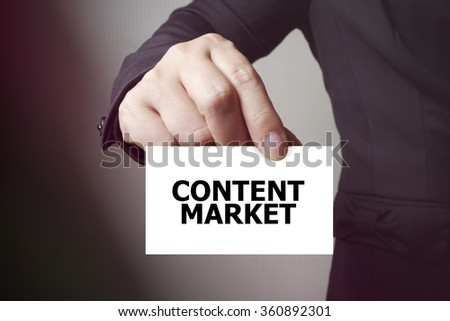 CONTENT MARKET paper on the card , business concept , business idea
