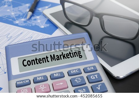 content marketing Calculator  on table with Office Supplies. ipad