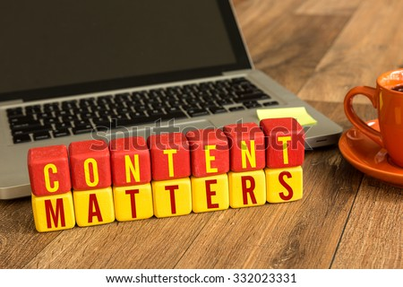Content Matters written on a wooden cube in front of a laptop - stock photo
