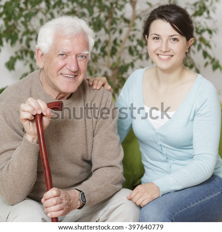 Content old man and granddaughter - stock photo
