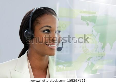 Content pretty businesswoman using futuristic interface hologram in bright office - stock photo