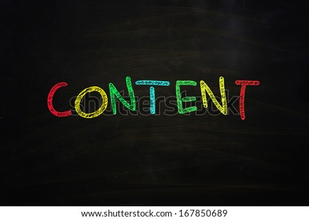 content word written with color chalk on blackboard - stock photo