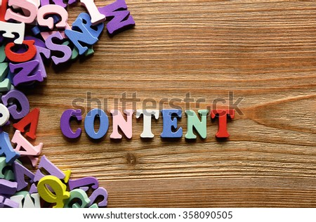 CONTENT  - words  made from multicolored   letters on wooden  background - stock photo