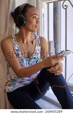 content young woman relaxing with headphones listening music - stock photo