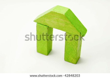Conteptual wooden building - stock photo