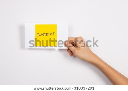 Context message concept. Hand holding post-it note