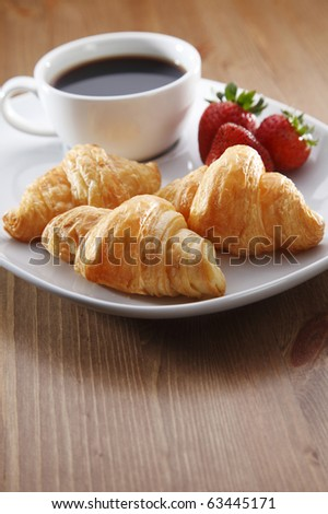 Continental breakfast with coffee and croissant - stock photo